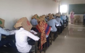 Polêmica contra cola: Fotos de alunos fazendo prova com caixa de papelão na cabeça para não 'colar' causam polêmica